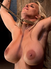 Smoking hot blond MILF with HUGE titsSuffers brutal crotch rope, pulled to the breaking point.